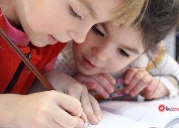 two kids writing buzzvale